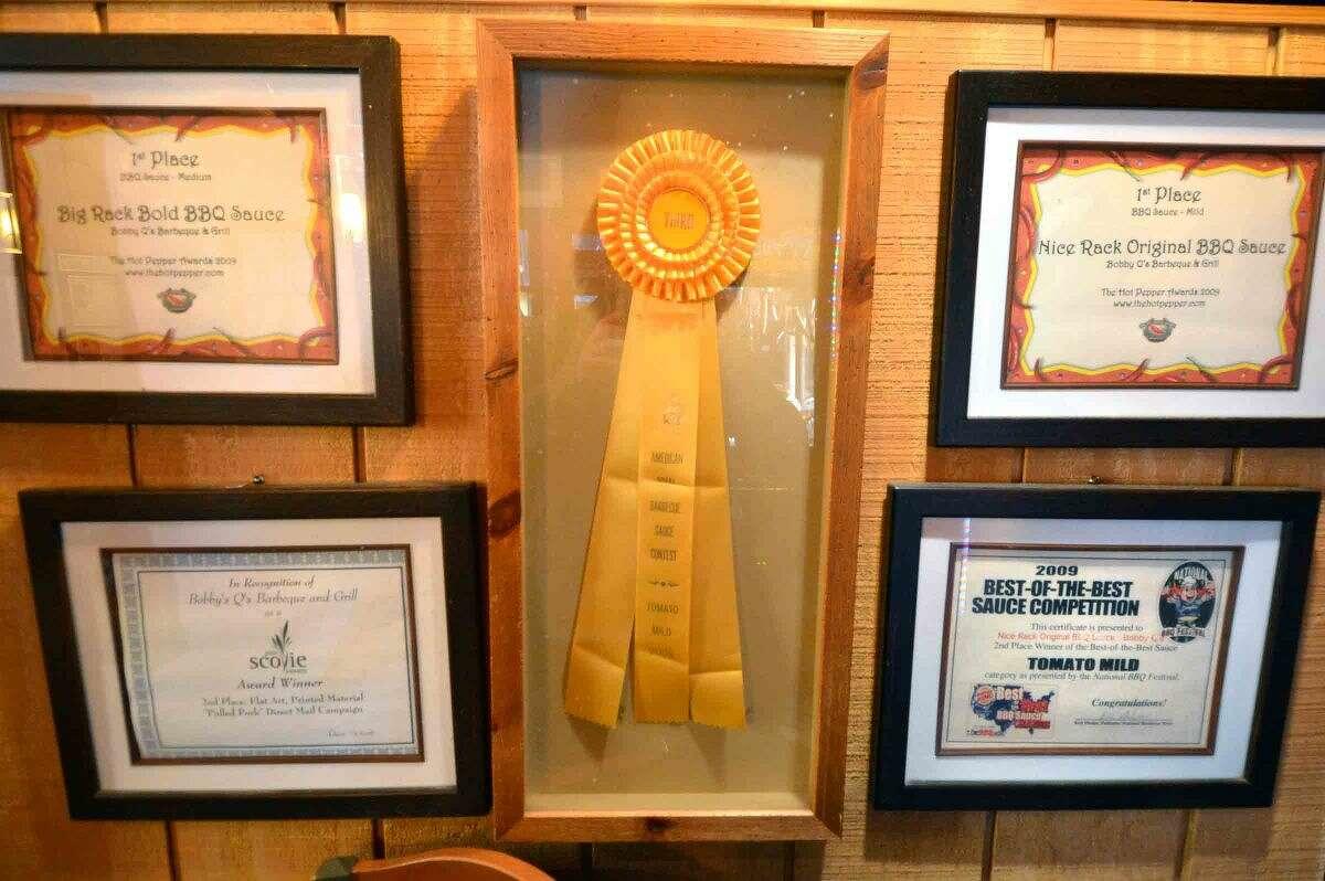 Hour Photo/Alex von Kleydorff Awards on the walls of Bobby Q's in Westport