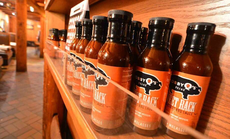 Hour Photo/Alex von Kleydorff Bottles of their award winning 'Sweet Rack' BBQ sauce at Bobby Q's