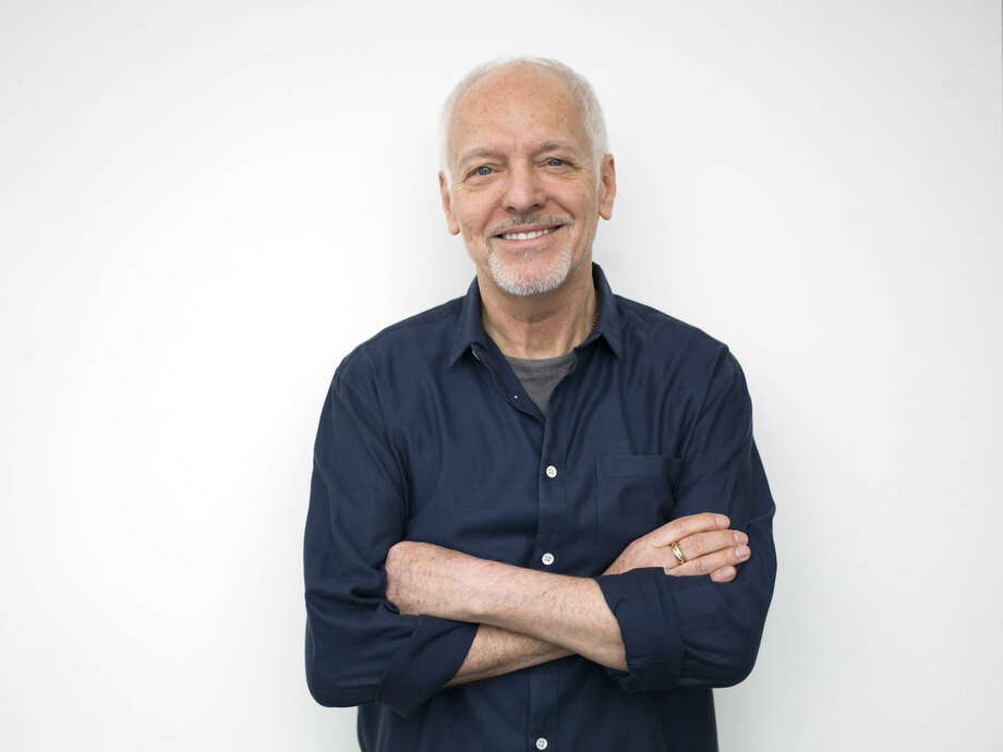 """Photo by Scott Gries/Invision/APIn this Feb. 25, photo, musician Peter Frampton poses for a portrait in New York. The English-born Frampton, now 65, released, """"Acoustic Classics"""" a CD of stripped-down versions of his best-known songs, in February."""