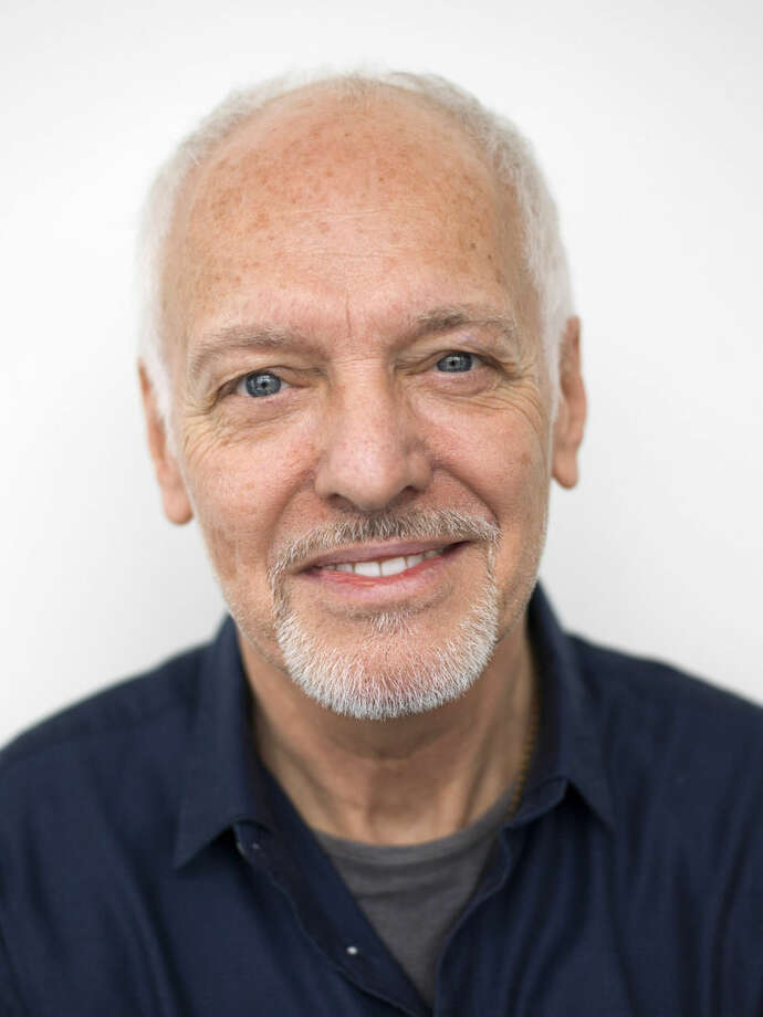 "In this Feb. 25, 2016 photo, musician Peter Frampton poses for a portrait in New York. The English-born Frampton, now 65, released, ""Acoustic Classics,"" a CD of stripped-down versions of his best-known songs, in February. (Photo by Scott Gries/Invision/AP)"
