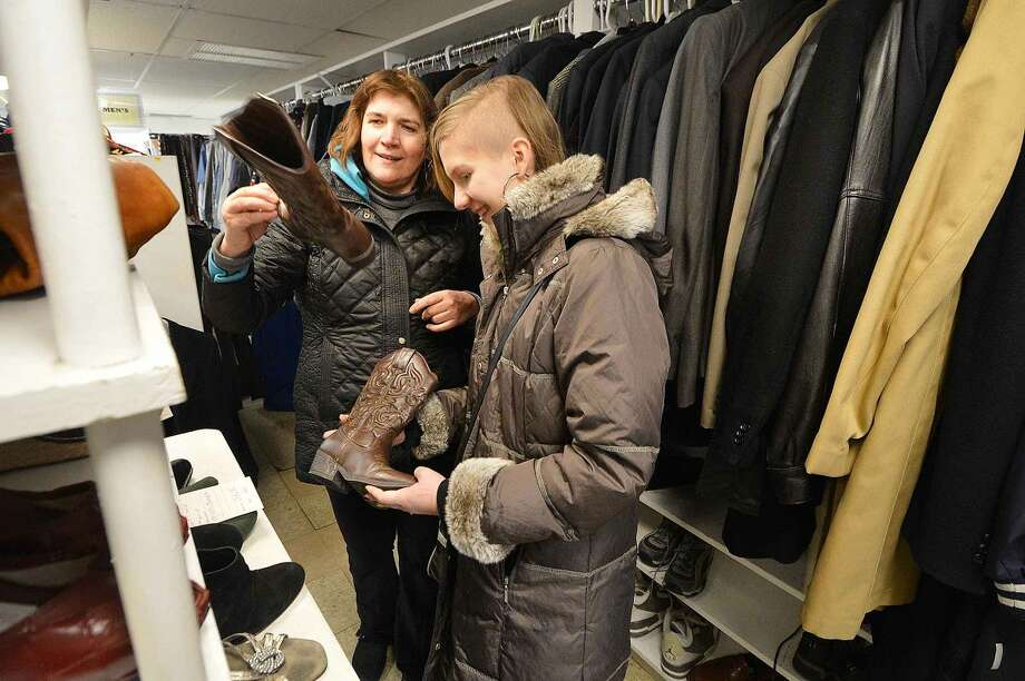 Hour Photo/Alex von Kleydorff Julia Matusiewicz and her mom Ewa find a pair of cowboy boots at The Turnover Shop in Wilton Center .