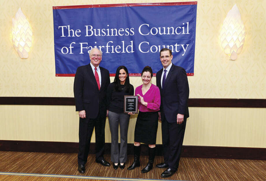 Hour photo / Erik TrautmannSuzanne Pullen and Greta Wagner of Chelsea Piers Stamford pose with Christopher Bruhl of The Business Council of Fairfield County and Matthew Fair of First Niagra Risk Management during the BCFC Healthy Workplace Employer Recognition Program Friday at the Sheraton Stamford Hotel.