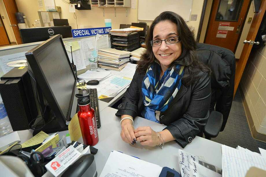 Stamford police Officer Adriana Molina at her desk in the Special Victims Unit at Stamford Police Headquarters.