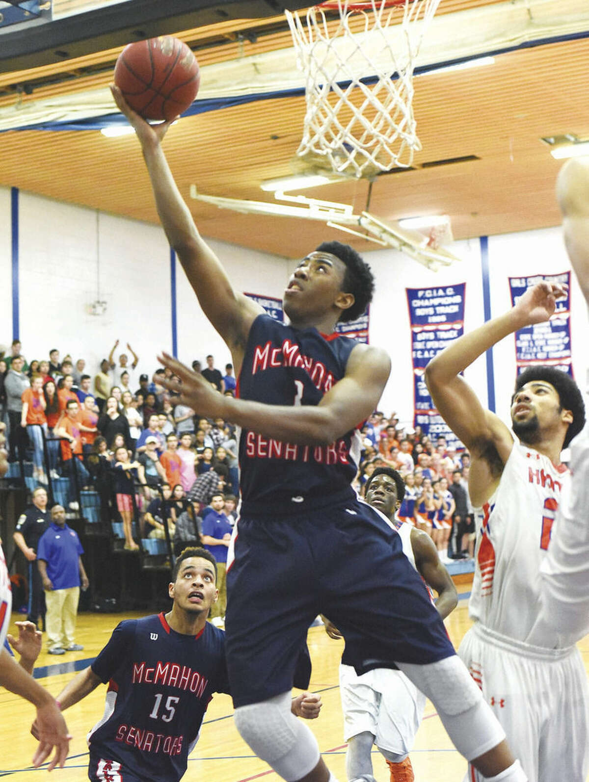 Hour photo/John Nash McMahon's David Civil puts up a shot for two of his 16 points during the Senators' 53-44 loss to Danbury in a CIAC Class LL second round game.