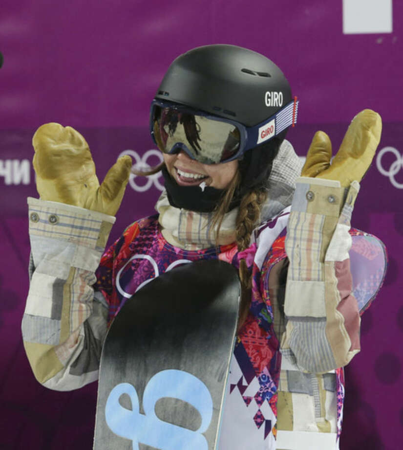United States' Kaitlyn Farrington reacts after her second run during the women's snowboard halfpipe final at the Rosa Khutor Extreme Park, at the 2014 Winter Olympics, Wednesday, Feb. 12, 2014, in Krasnaya Polyana, Russia. (AP Photo/Sergei Grits)
