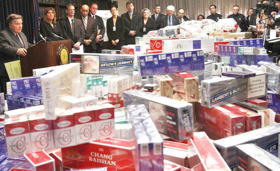 AP photo file / Frank Franklin IIIn this April 21, 2011, file photo, Queens District Attorney Richard Brown, left, joins state and federal officials in the Queens borough of New York to announce a crackdown on cigarette smugglers and tax evaders behind a display of cartons of confiscated cigarettes.