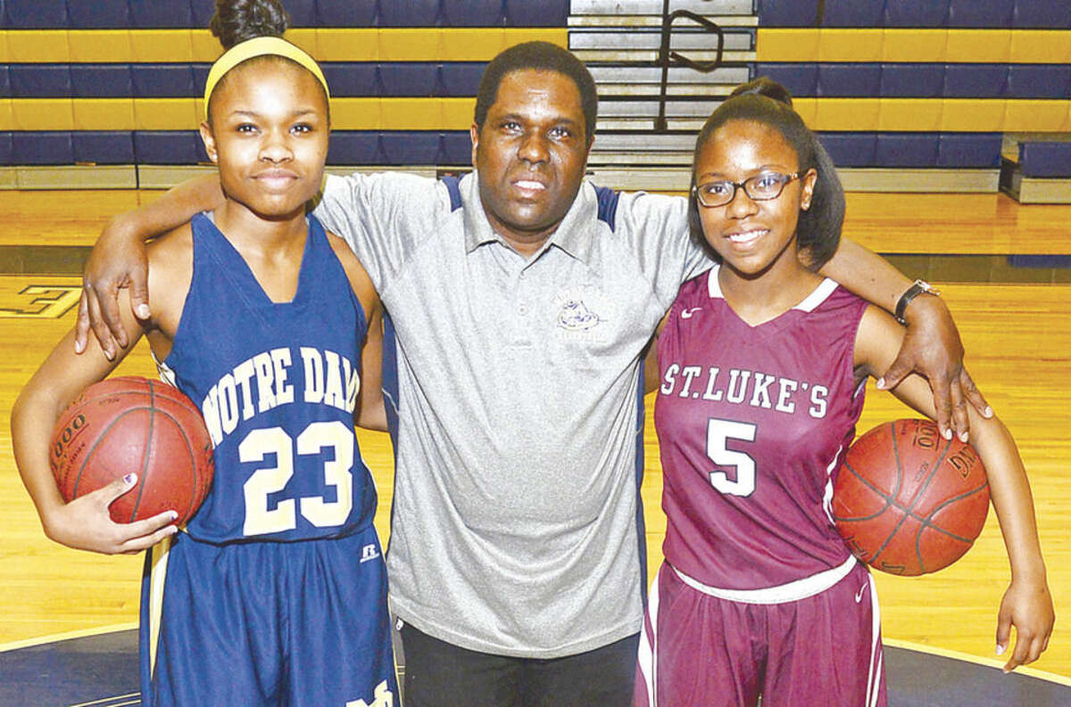 Hour photo / Erik Trautmann Notre Dame Catholic School assistant girls basketball coach Rick Fulton and his daughters Whitney and Tami Fulton of Norwalk who dominate are from Norwalk the sport in the respective schools.