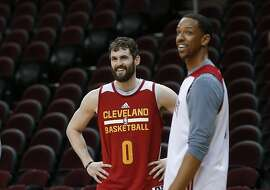 Cleveland Cavaliers forward Kevin Love (0) smiles with Channing Frye during practice for Game 4 of basketball's NBA Finals against the Golden State Warriors in Cleveland, Thursday, June 9, 2016. (AP Photo/Paul Sancya)