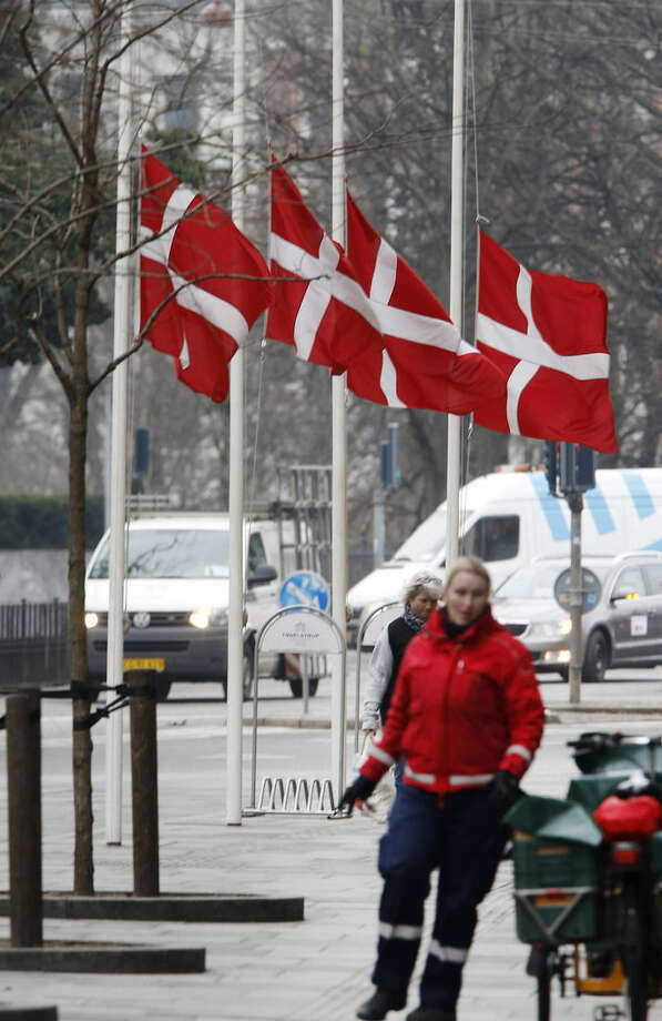 Danish flags are on half-mast in Copenhagen, Denmark, Monday, Feb. 16, 2015 after an alleged shooter killed two persons. Danish police shot and killed the man early Sunday suspected of carrying out shooting attacks at a free speech event and then at a Copenhagen synagogue, killing a Danish documentary filmmaker and a member of the Scandinavian country's Jewish community. (AP Photo/Michael Probst)