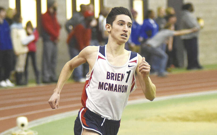 Hour photo/John Nash - Brien McMahon's Eric van der Els won the 1,600 and 3,200 at Monday's Class LL indoor track championship meet.
