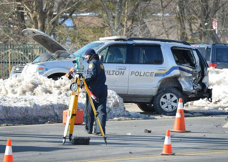 Wilton police investigate an accident involving one of their SUV police vehicles on Route 7 on Tuesday.