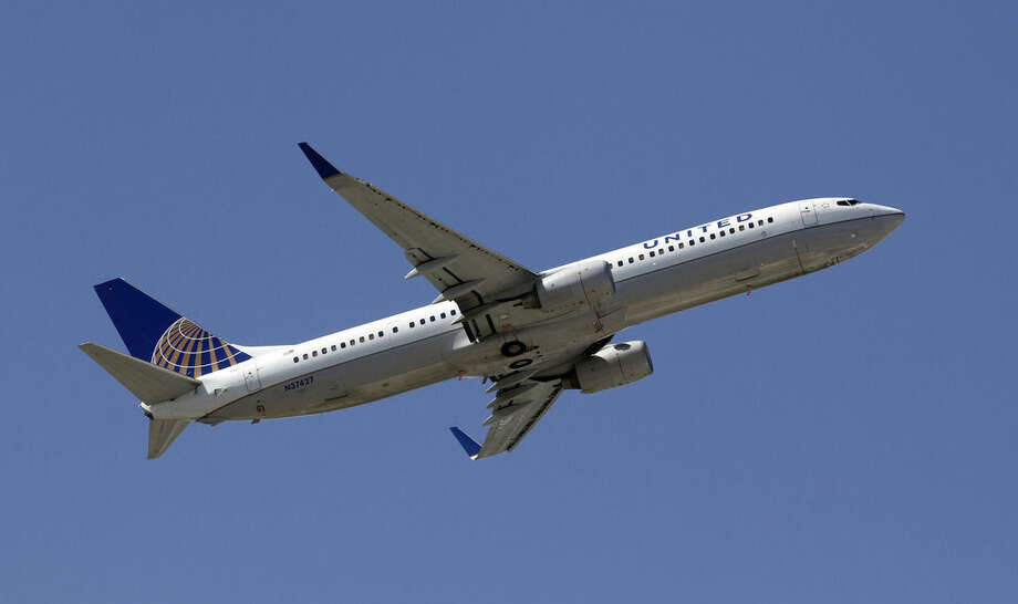 FILE - This Monday, Aug. 20, 2012, file photo, shows a United Airlines aircraft taking off at Miami International Airport in Miami. In a letter made public Tuesday, March 8, 2016, two activist investors said they are pushing United Continental to shake up its board by adding six new members, including former Continental Airlines CEO Gordon Bethune. (AP Photo/Alan Diaz, File)