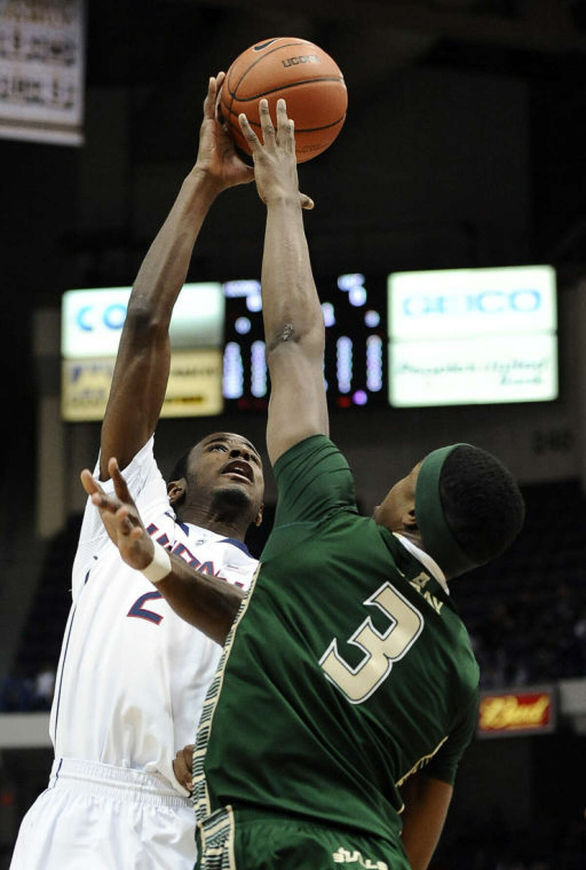 Connecticut's DeAndre Daniels shoots over South Florida's Zach LeDay, right, during the first half of an NCAA college basketball game on Wednesday, Feb. 12, 2014, in Hartford, Conn. (AP Photo/Jessica Hill)