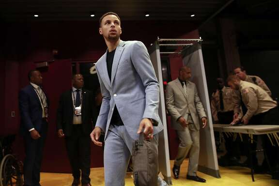 Warriors' Stephen Curry arrives at the arena as the Golden State Warriors prepare for game 4 against Cleveland Cavalier in the NBA Championship at Quicken Loans Arena in Cleveland, Ohio on Fri. June 10, 2016.