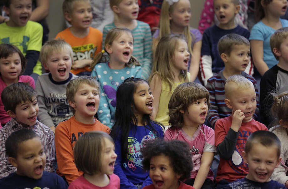 ADVANCE FOR USE WEDNESDAY, FEB. 18, 2014 AND THEREAFTER - In this Wednesday, Dec. 17, 2014 photo, Watford City Elementary School students attend an assembly in Watford City, N.D. The school's 700-plus enrollment is more than double that of 2011. Many of the newcomers are the offspring of riggers, welders, truck drivers, engineers and others lured from across America _ and around the world _ by the prospects of good jobs. (AP Photo/Eric Gay)