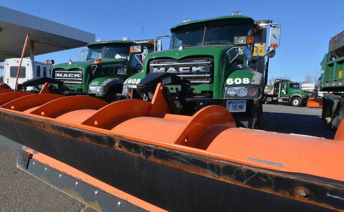 Hour Photo/Alex von Kleydorff Snowplows ready and waiting at DPW for this weekends snow