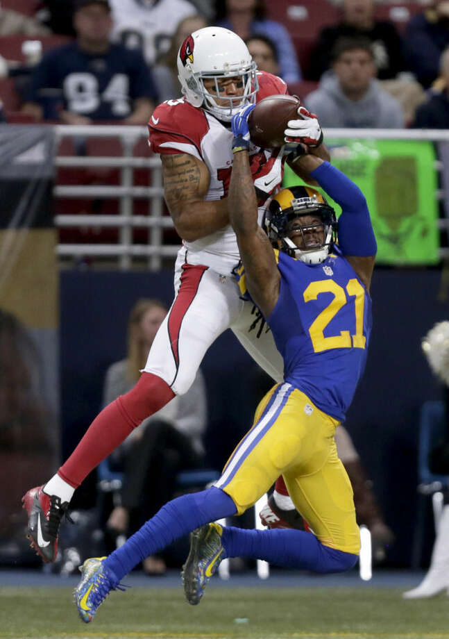 FILE - Int his Dec. 6, 2015, file photo, St. Louis Rams cornerback Janoris Jenkins (21) breaks up a pass intended for Arizona Cardinals wide receiver Michael Floyd during the second quarter of an NFL football game in St. Louis. The New York Giants are set to sign top free-agent cornerback Janoris Jenkins to a longterm contract. Jenkins, one of the NFL's top cornerbacks, expects to sign a five-year deal worth about $60 million later Wednesday afternoon, March 9, 2016, when the free-agent signing period begins. (AP Photo/Tom Gannam, File)