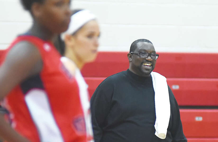 Hour photo/John Nash Mark McElveen, the former girls basketball coach at Brien McMahon, was all smiles during his team's season-opening win against New Canaan. After going 3-17 this season, McElveen's contract as coach was not renewed by the school last week.