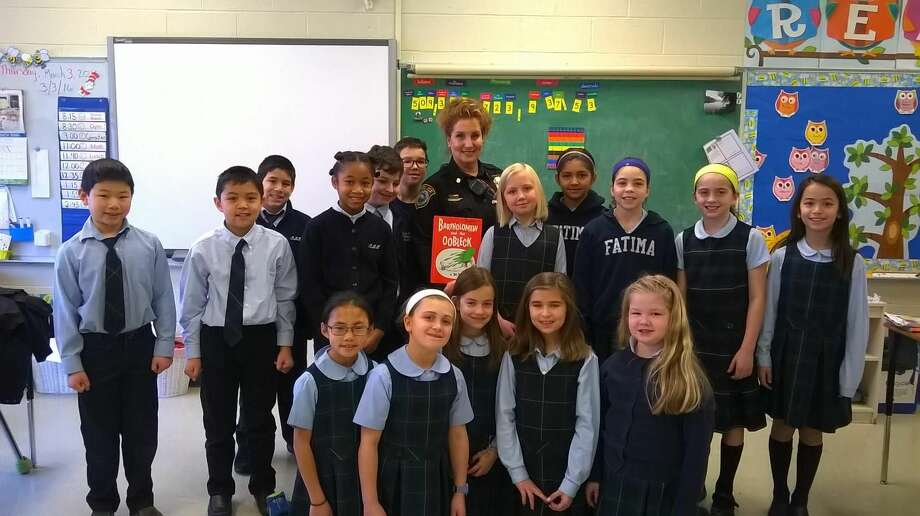 "In celebration of ""Read Across America,"" Our Lady of Fatima School's fourth grade class hosted Wilton Police Officer Diane MacLean."