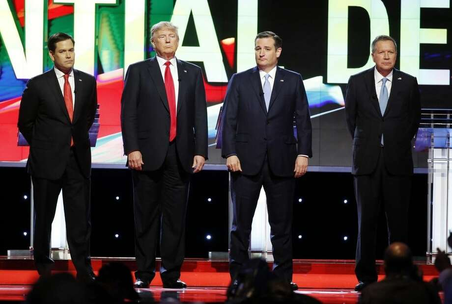 Republican presidential candidates, Sen. Marco Rubio, R-Fla., left, Donald Trump, Sen. Ted Cruz, R-Texas, and Ohio Gov. John Kasich, right, stand together before the start of the Republican presidential debate sponsored by CNN, Salem Media Group and the Washington Times at the University of Miami, Thursday, March 10, 2016, in Coral Gables, Fla. (AP Photo/Wilfredo Lee)