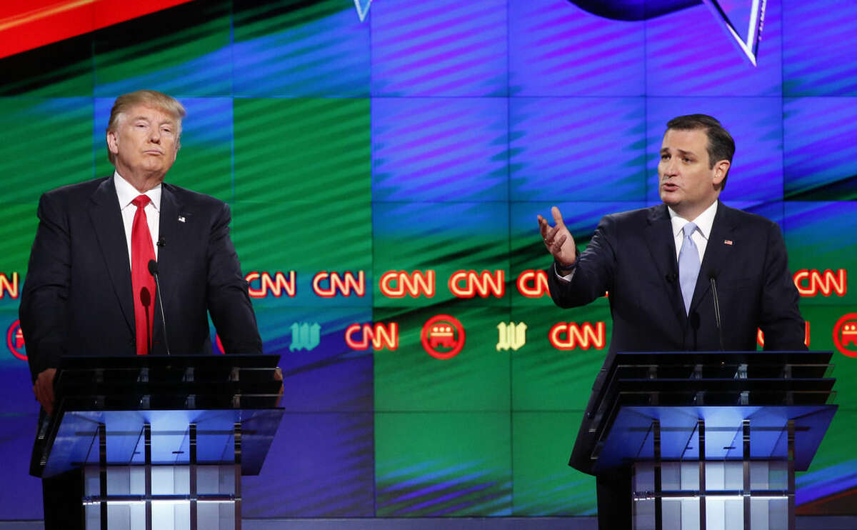 Republican presidential candidate, Sen. Ted Cruz, R-Texas, speaks as Republican presidential candidate, businessman Donald Trump listens, during the Republican presidential debate sponsored by CNN, Salem Media Group and the Washington Times at the University of Miami, Thursday, March 10, 2016, in Coral Gables, Fla. (AP Photo/Wilfredo Lee)