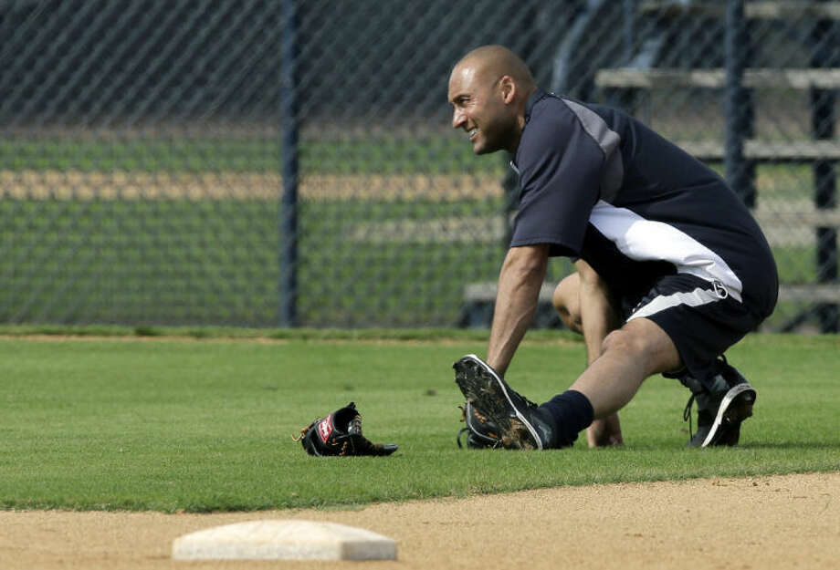 New York Yankees shortstop Derek Jeter stretches during practice at the Yankees' minor league facility Wednesday, Feb. 12, 2014, in Tampa, Fla. Jeter says he will retire after this season. Jeter posted a long letter on his Facebook account Wednesday, Feb. 12, 2014, saying the 2014 will be his last year playing professional baseball.(AP Photo/Chris O'Meara)