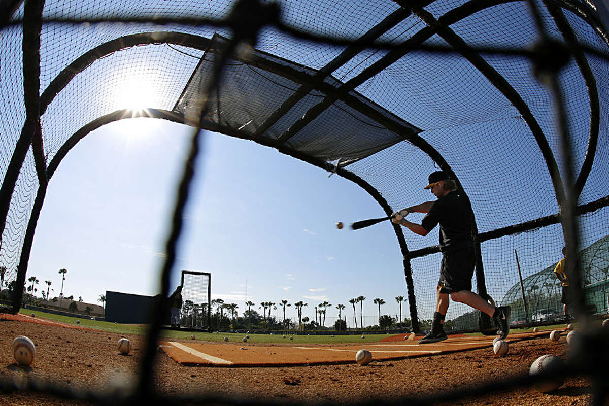 A Pittsburgh Pirates minor league player takes batting practice during an informal spring training baseball workout in Bradenton, Fla., Monday, Feb. 16, 2015. The first official workout for pitchers and catchers is Thursday, Feb. 19. (AP Photo/Gene J. Puskar)