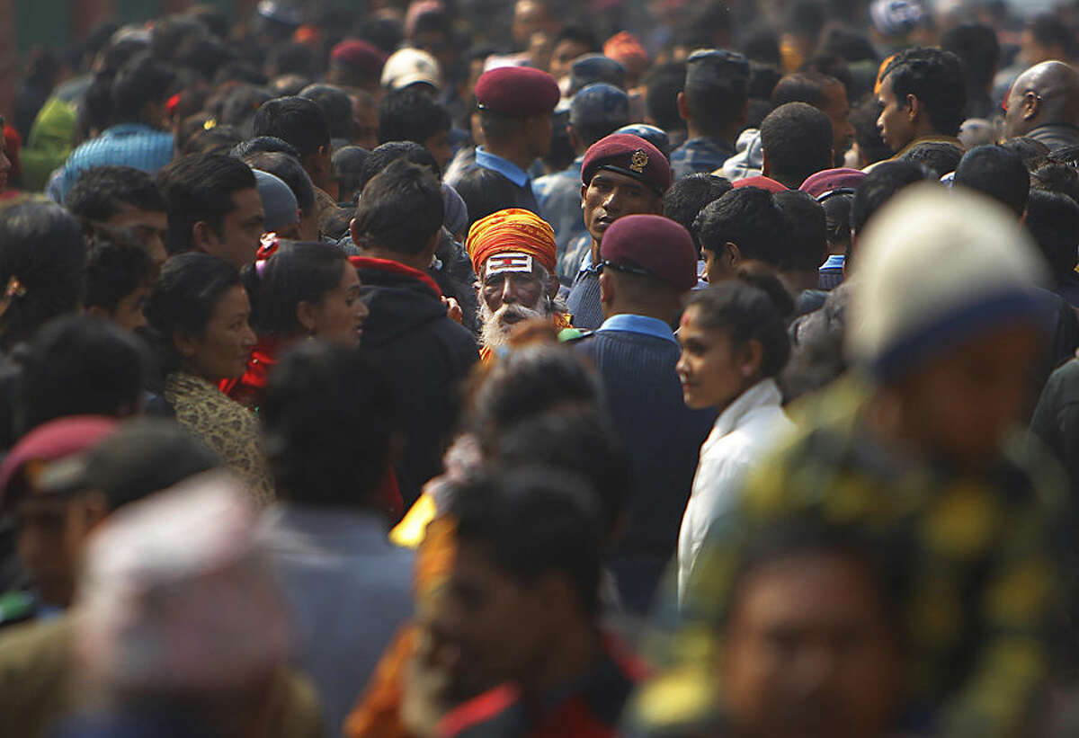 A Hindu holy man walks amid a sea of devotees at the Pashupatinath temple during Shivratri festival in Kathmandu, Nepal, Tuesday, Feb. 17, 2015. Shivaratri, or the night of Shiva, is dedicated to the worship of Lord Shiva, the Hindu god of destruction. (AP Photo/Niranjan Shrestha)
