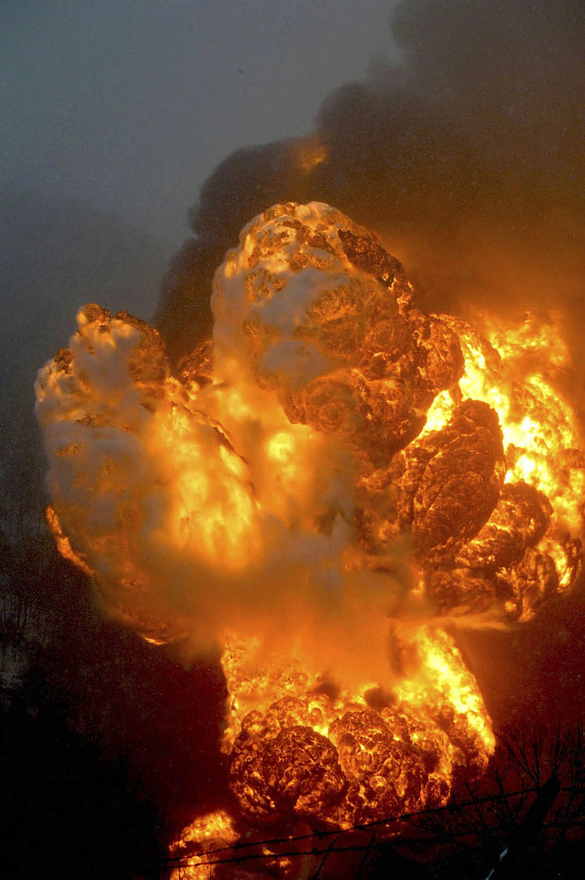 A fire burns Monday, Feb. 16, 2015, after a train derailment near Charleston, W.Va. Nearby residents were told to evacuate as state emergency response and environmental officials headed to the scene. (AP Photo/The Register-Herald, Steve Keenan)