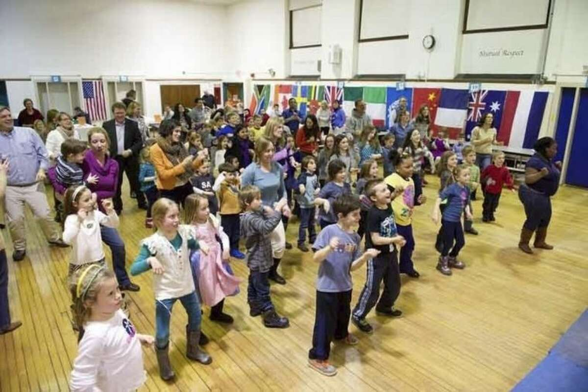 Submitted photo On Friday, Feb. 6, Rowayton Elementary School hosted Heritage Night, event that celebrates the cultural heritages of the community with a potluck dinner, dancing and socializing. Families cooked and brought their dishes to share.