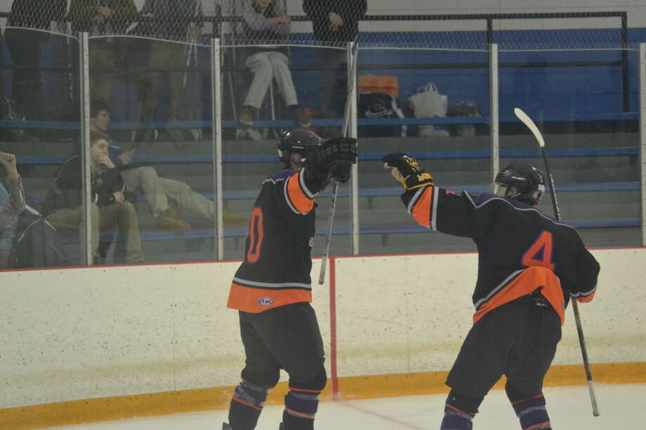 Westhill-Stamford's Nick Rich celebrates his first goal of the game with teammates Cooper Healy on Thursday night.