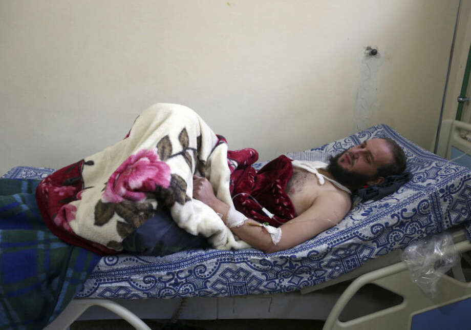 Syrian Abu Usama, 29, who was wounded in Yabroud as a result of Syrian government shelling, rests in a field hospital at the Lebanese-Syrian border town of Arsal in eastern Lebanon, Thursday, Feb. 13, 2014. Syrian troops pounded Thursday the town of Yabroud the last rebel stronghold in Syria's mountainous Qalamoun region, forcing hundreds to flee into the nearby Lebanese town of Arsal. Backed by Lebanon's Hezbollah fighters, the Syrian army has been on a crushing offensive in the region since early December. (AP Photo/Bilal Hussein)