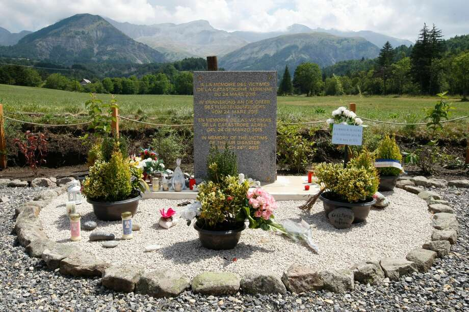 FILE - In this July 24, 2015 file picture a stele, a stone slab erected as a monument, set up in the area near where a Germanwings aircraft crashed in the French Alps, in Le Vernet, French Alps. France's air accident investigation agency releases report into the March 2015 crash of the Germanwings jet on March 13, 2016 . (AP Photo/Claude Paris,file)