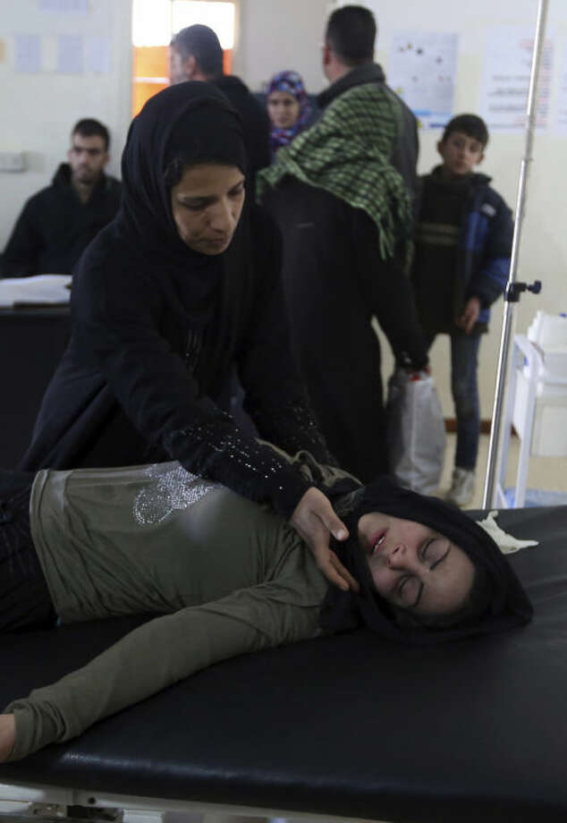 A Syrian woman who was wounded in Yabroud as a result of Syrian government shelling, rests in a field hospital at the Lebanese-Syrian border town of Arsal in eastern Lebanon, Thursday, Feb. 13, 2014. Syrian troops pounded Thursday the town of Yabroud the last rebel stronghold in Syria's mountainous Qalamoun region, forcing hundreds to flee into the nearby Lebanese town of Arsal. Backed by Lebanon's Hezbollah fighters, the Syrian army has been on a crushing offensive in the region since early December. (AP Photo/Bilal Hussein)
