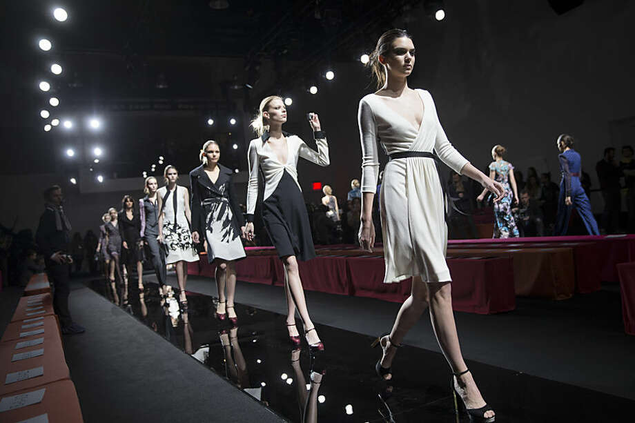 Model Kendall Jenner leads a finale during rehearsal before the Diane von Furstenberg Fall 2015 collection is modeled during Fashion Week, Sunday, Feb. 15, 2015, in New York. (AP Photo/John Minchillo)