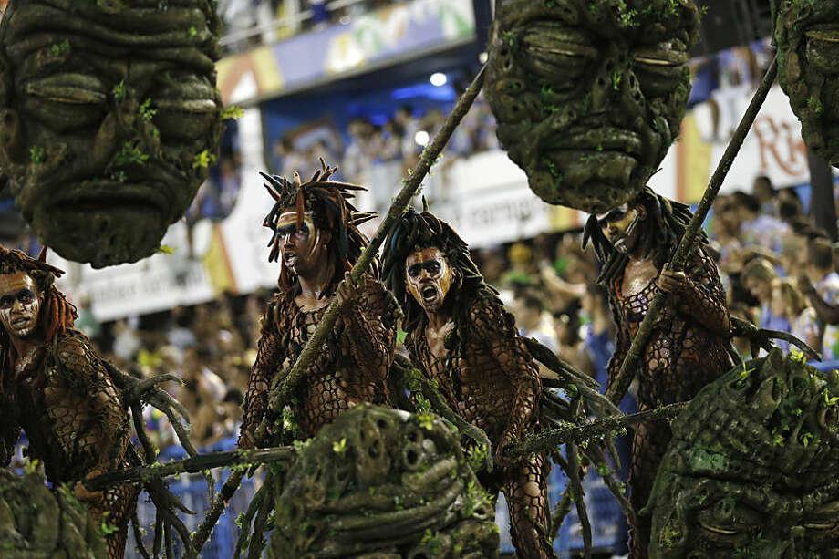 Performers from the Beija Flor samba school, parade during Carnival celebrations at the Sambadrome in Rio de Janeiro, Brazil, Tuesday, Feb. 17, 2015. (AP Photo/Silvia Izquierdo)