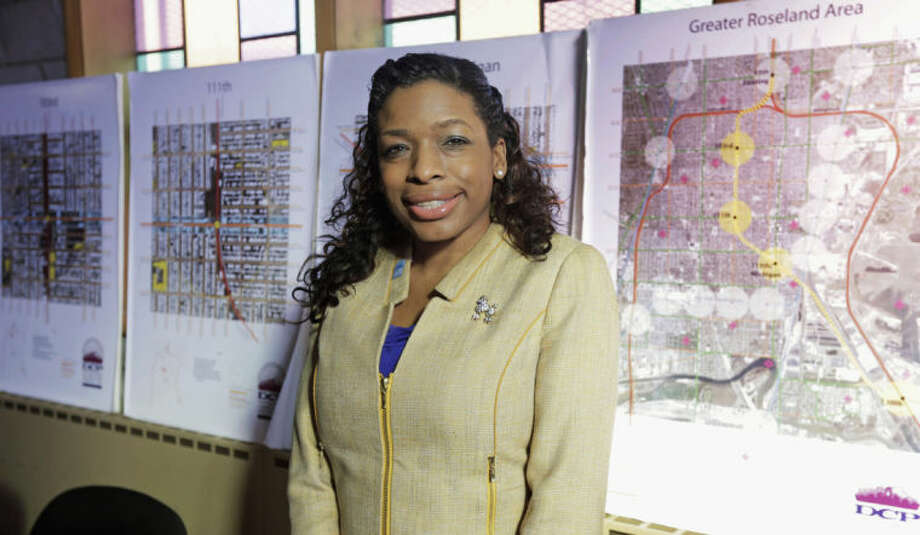 This Friday, Feb. 7, 2014 photo shows Tiffany Hightower, executive director of the not-for-profit Developing Communities Project, Inc. in her office in the south side neighborhood of Roseland in Chicago. Hightower is part of a group trying to bring a Barack Obama presidential library to Chicago State University. She believes the library would transform the area and give young people a link to the world beyond their violence-plagued streets. (AP Photo/M. Spencer Green)