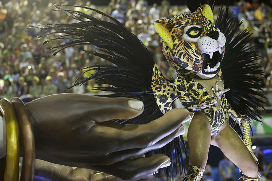 A performer from the Imperatriz Leopoldinense samba school parades on a float during carnival celebrations at the Sambadrome in Rio de Janeiro, Brazil, Tuesday, Feb. 17, 2015. (AP Photo/Felipe Dana)