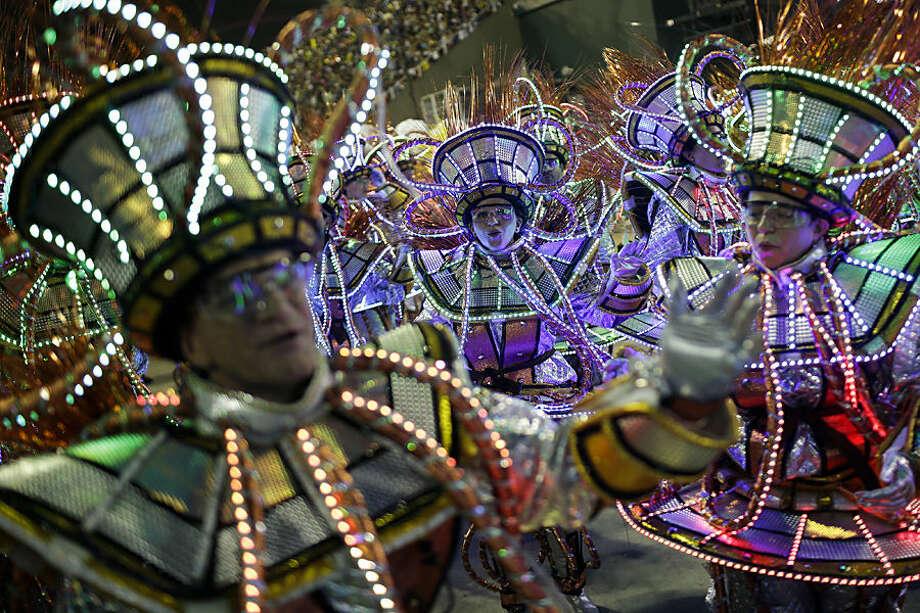 Performers from the Unidos da Tijuca samba school parade during carnival celebrations at the Sambadrome in Rio de Janeiro, Brazil, early Tuesday, Feb. 17, 2015. (AP Photo/Felipe Dana)