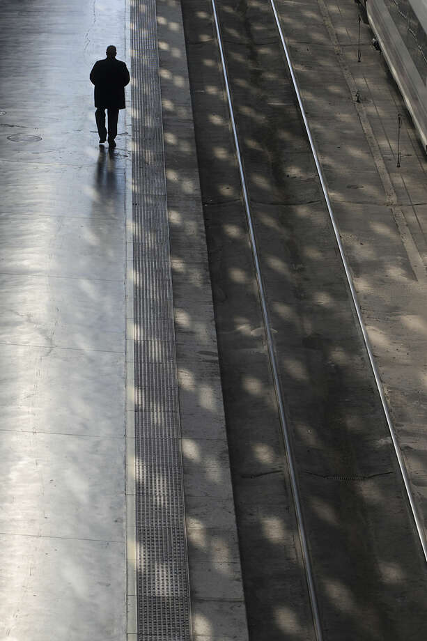 A man walks on a platform at Atocha train station in Madrid, Spain, Friday, March 11, 2016 Friday marks the 12th anniversary of Europe's worst Islamic terrorist attack which killed 191 people.The attackers targeted four commuter trains with 10 shrapnel-filled bombs concealed in backpacks during morning rush hour on March 11, 2004. (AP Photo/Paul White)