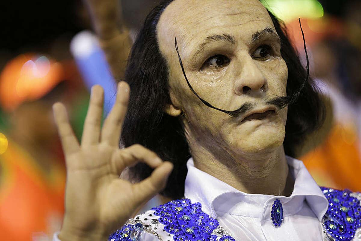 A Portela samba school performer dressed to resemble Spanish surrealist painter Salvador Dali, files past in the Carnival parade at the Sambadrome in Rio de Janeiro, Brazil, Monday, Feb. 16, 2015. (AP Photo/Felipe Dana)