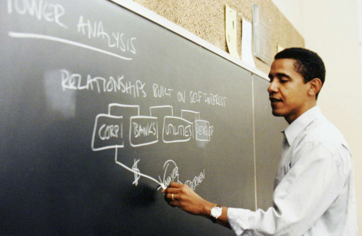 FILE - This undated file photo released by Obama for America shows Barack Obama teaching at the University of Chicago Law School in Chicago. The contest to host the Obama presidential library has set off some classic Chicago infighting between activists in depressed neighborhoods and wealthy universities. The main point of tension is between the University of Chicago, where Obama spent 12 years as a constitutional law professor until his 2004 election to the U.S. Senate, and a group advocating for Bronzeville, the city?'s historic center of black culture, business and politics. (AP Photo/Obama for America, File) NO SALES