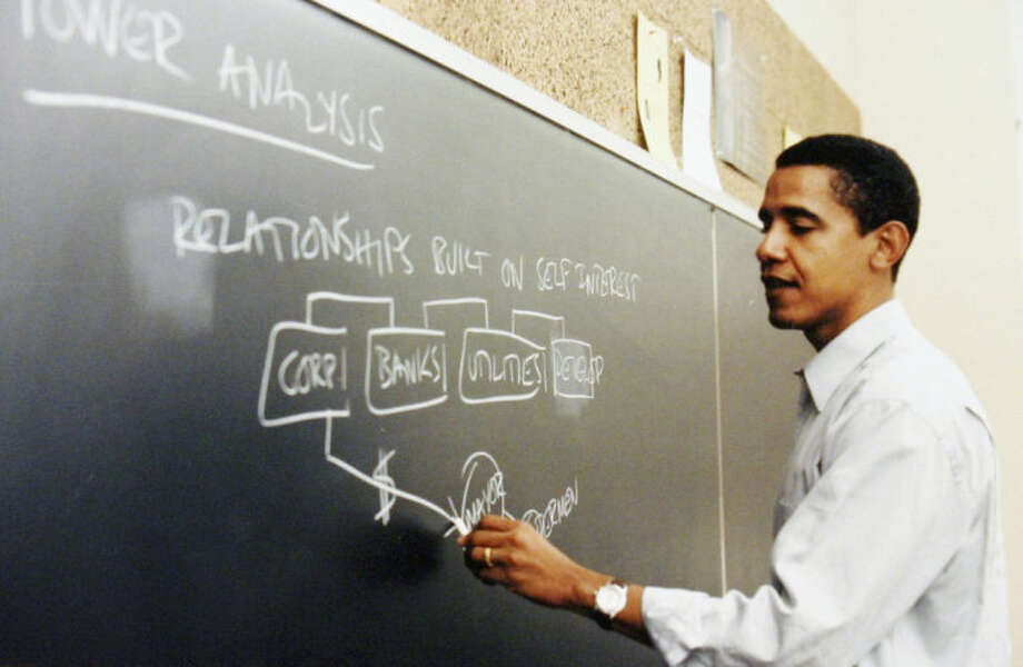 FILE - This undated file photo released by Obama for America shows Barack Obama teaching at the University of Chicago Law School in Chicago. The contest to host the Obama presidential library has set off some classic Chicago infighting between activists in depressed neighborhoods and wealthy universities. The main point of tension is between the University of Chicago, where Obama spent 12 years as a constitutional law professor until his 2004 election to the U.S. Senate, and a group advocating for Bronzeville, the city's historic center of black culture, business and politics. (AP Photo/Obama for America, File) NO SALES