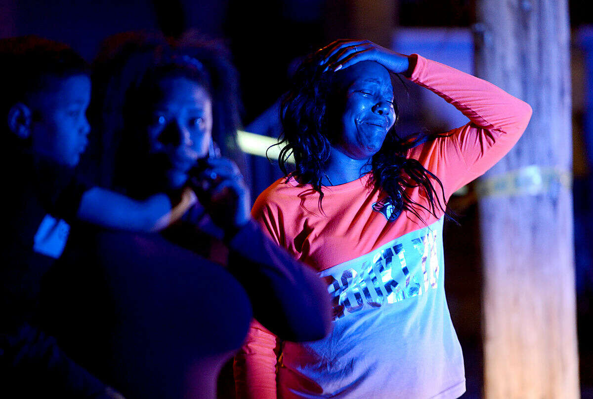 A woman reacts at the scene of a deadly shooting in Wilkinsburg, Pa., Thursday, March 10, 2016. Police say multiple people were killed in the shooting late Wednesday and several were injured in suburban Pittsburgh. (Michael Henninger/Pittsburgh Post-Gazette via AP) MAGS OUT; MONESSEN OUT; KITTANNING OUT; CONNELLSVILLE OUT; GREENSBURG OUT; TARENTUM OUT; NORTH HILLS NEWS RECORD OUT; BUTLER OUT; MANDATORY CREDIT
