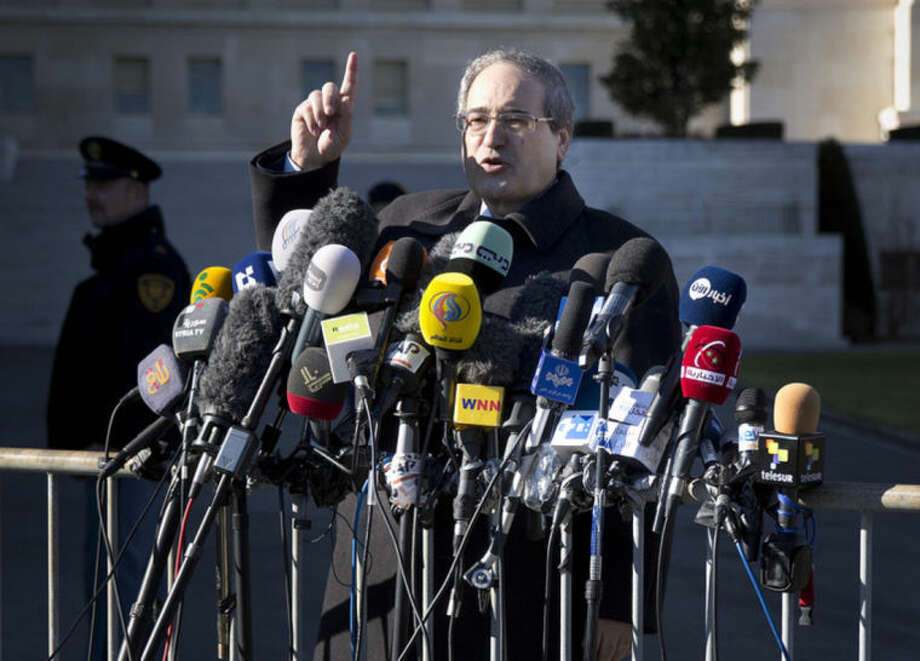 Syrian Deputy Foreign Minister Faisal Mekdad gestures as he talks to journalists after a meeting with the Syrian opposition at the United Nations headquarters in Geneva, Switzerland, Switzerland, Wednesday, Feb. 12, 2014. Russian Deputy Minister of Foreign Affairs Gennady Gatilov arrived in Geneva and met with U.N. mediator Lakhdar Brahimi who was pessimistic over any progress at the talks. (AP Photo/Anja Niedringhaus)