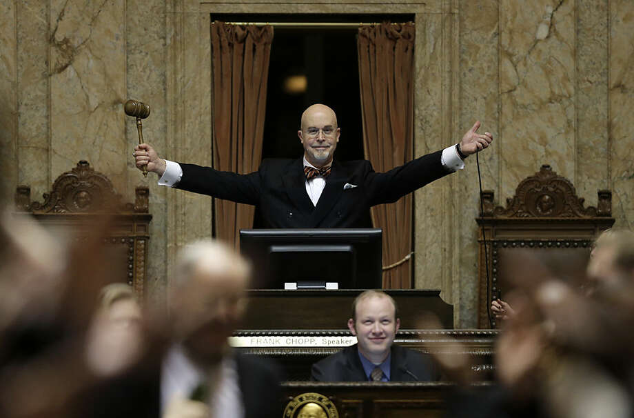 "Rep. Jim Moeller, D-Vancouver, and Speaker Pro Tempore of the Washington House, raises his gavel after declaring ""Sine Die"" Thursday, March 10, 2016, to end the regular session of the Washington Legislature, at the Capitol in Olympia, Wash. (AP Photo/Ted S. Warren)"