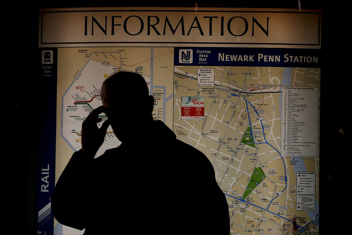 A commuter looks at an map at Newark Penn Station, Friday, March 11, 2016, in Newark, N.J. More than 100,000 commuters use NJ Transit to get into New York City, and the transit agency says its contingency plan using extra buses will only be able to accommodate about 40,000 riders. NJ Transit has estimated that a one-hour commute by train will more than double. (AP Photo/Julio Cortez)