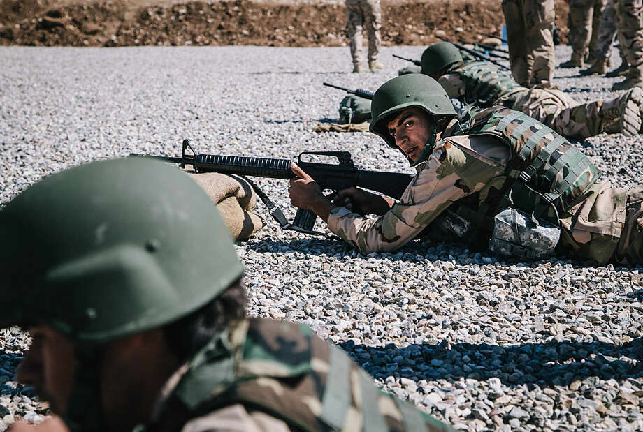 Kurdish Peshmerga soldier aim their weapons during a military training session held by Dutch army trainers at a shooting range, at Bnaslawa Military Base in Irbil, northern Iraq, Wednesday, March 9, 2016. Kurdish Peshmerga soldiers received their second monthly salary this year as the Kurdish Regional Government struggles with a deep financial crisis caused by the drop in oil prices. (AP Photo/Alice Martins)