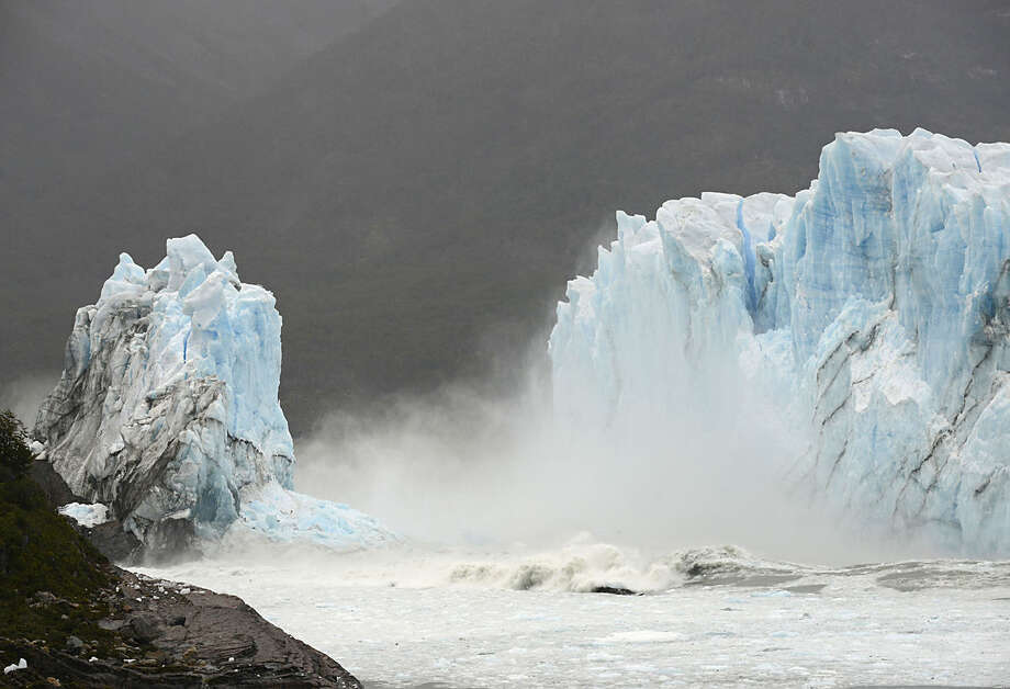Mist rises from Lake Argentina, after the Perito Moreno Glacier's ice bridge collapsed into the lake at Los Glaciares National Park, near El Calafate, in Argentina's Patagonia region, Thursday, March 10, 2016. The massive natural monument in the province of Santa Cruz periodically advances over the lake, and then breaks off. The glacier last ruptured in March 2012. (AP Photo/Francisco Munoz)