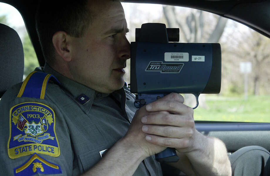 Connecticut State Police Trooper First Class David Koonitsky monitors traffic with a radar gun along Interstate-95 south in Fairfield. Photo: File Photo / Connecticut Post File Photo